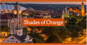 Shades of Orange banner over Syracuse University campus at sunset
