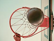 Photo: Basketball going through hoop